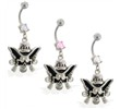 Navel ring with dangling cowboy skull and guns