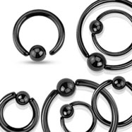 Black stainless steel captive bead ring with one sided fixed ball, 18 ga