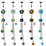 Belly ring with dangling chains and precious stones