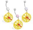 Navel ring with dangling yellow firefighter's emblem
